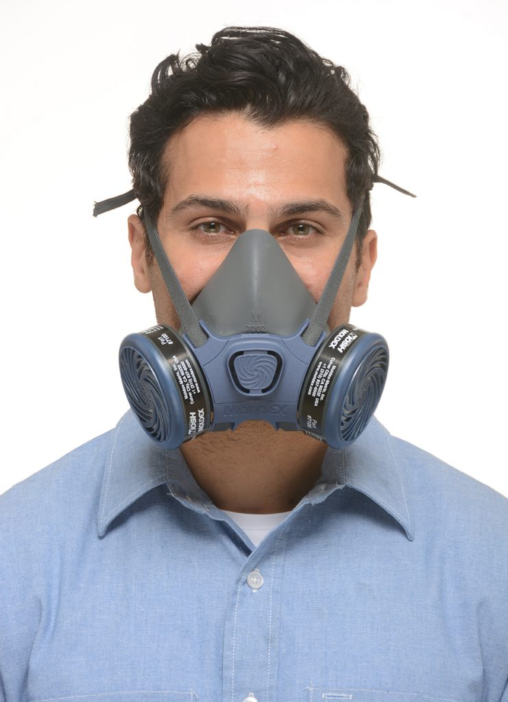 view from the front of a man wearing reusable half-face respirator mask
