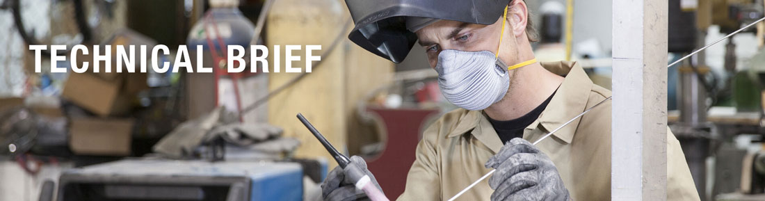 welder in work area wearing disposable respiratory face mask